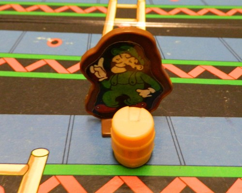 Colliding with barrel in Donkey Kong board game