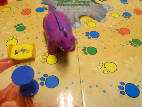 Knocked Down Playing Pieces in Dizzy Dizzy Dinosaur