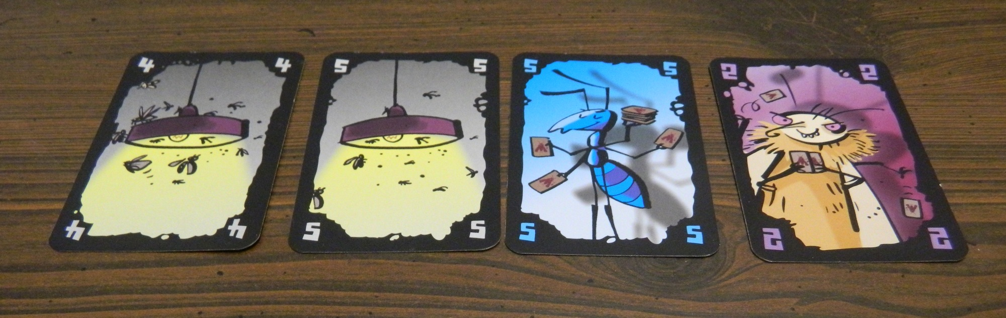 Cheating Moth Card Game Review and Rules | Geeky Hobbies