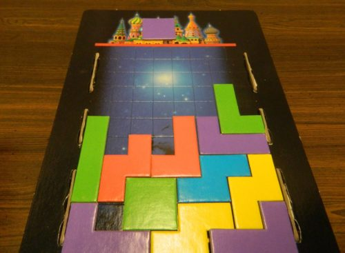 Giving a Block in the Tetris Board Game