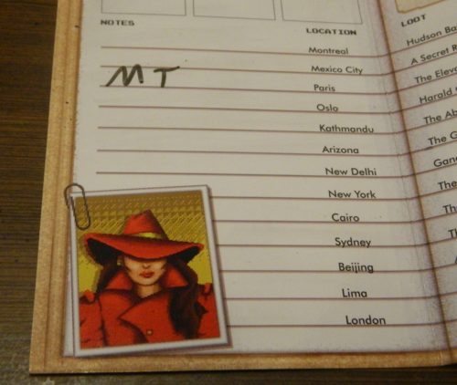 Taking Notes in Where In The World Is Carmen Sandiego? Card Game