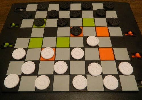Jumping Pieces in Trapdoor Checkers