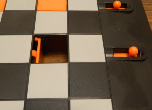 Pulling Knob in Trapdoor Checkers