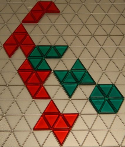 Tile Placement in Blokus Trigon